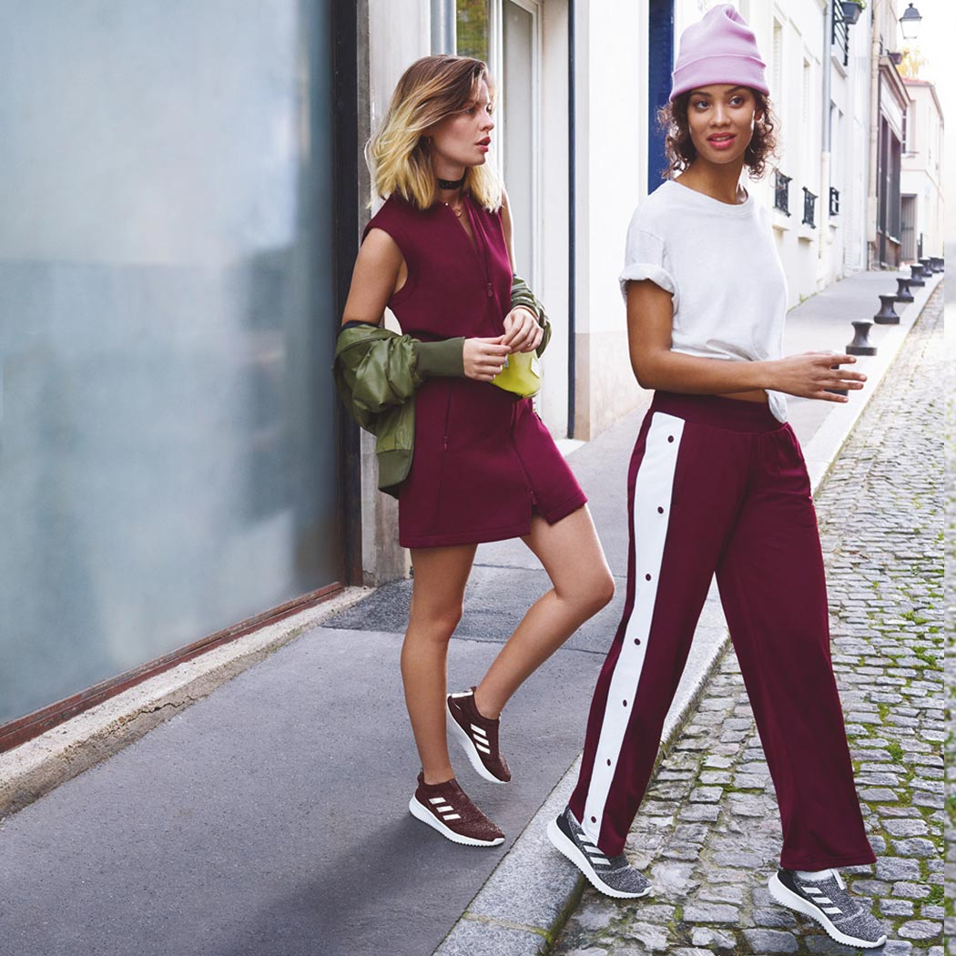 Cool women wearing adidas sneakers