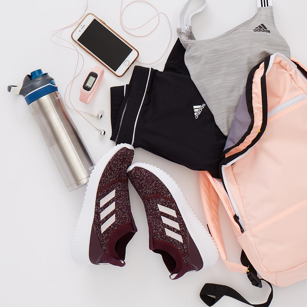 style report with adidas workout clothes and a pair of adidas slip-on sneakers
