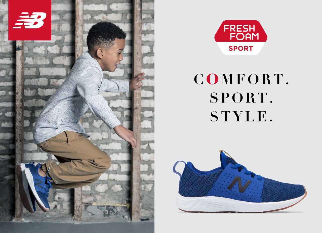 young boy jumping wearing new balance sneakers