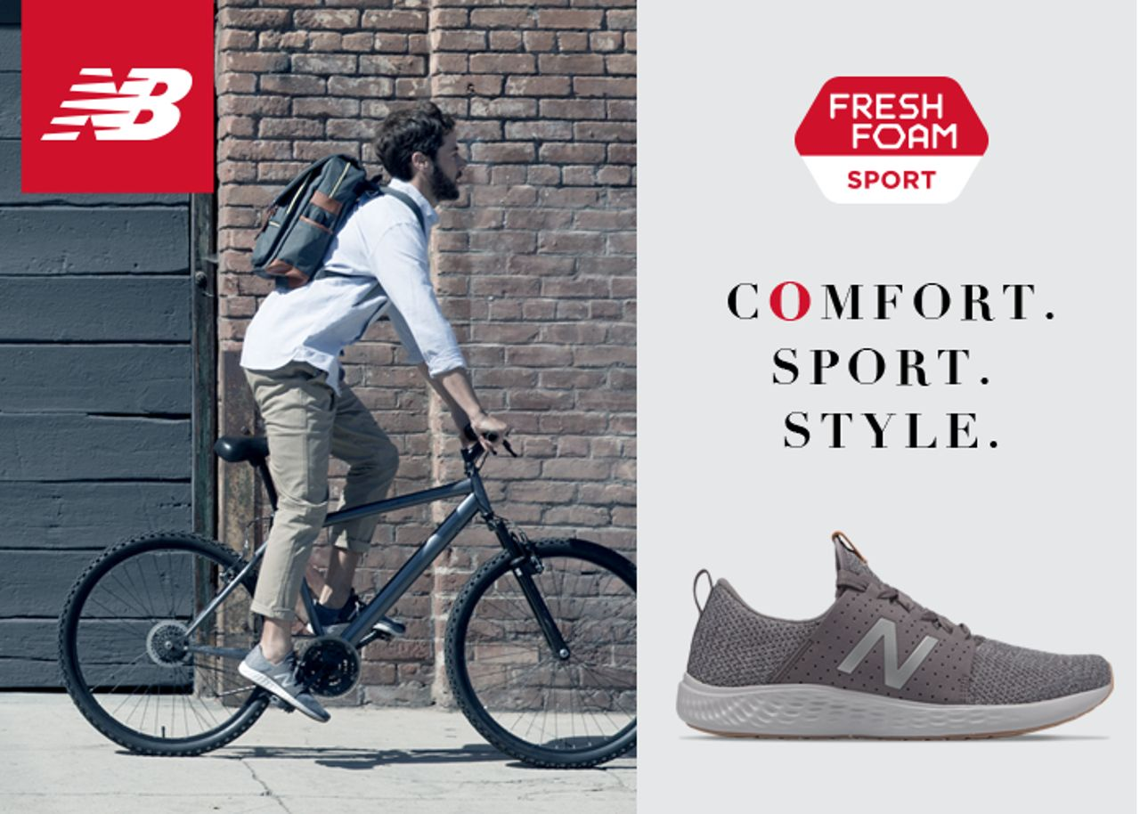 man riding bike wearing new balance sneakers