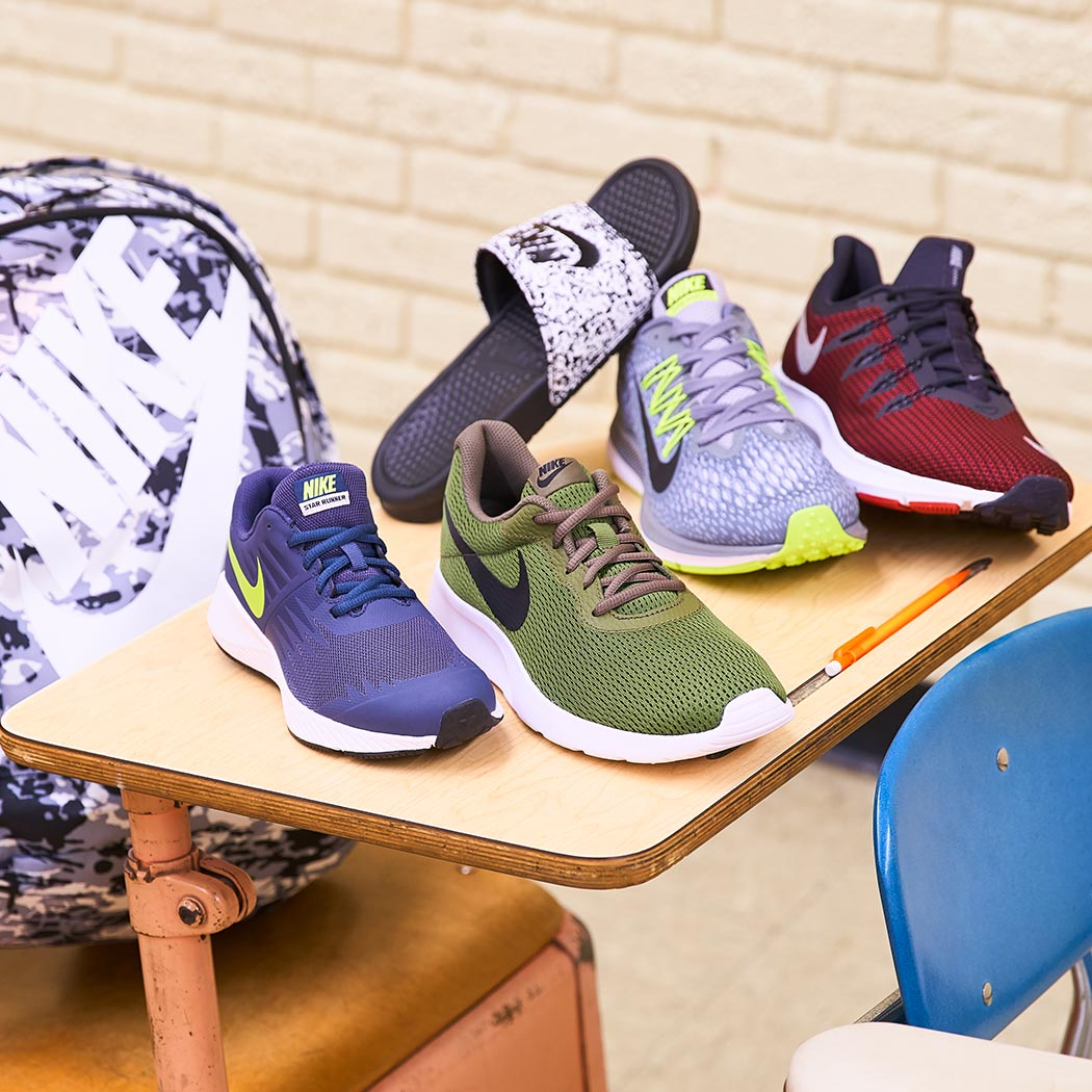 assorted men's nike athletic shoes, slide, and backpack