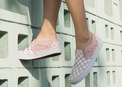 pair of pink vans sneakers