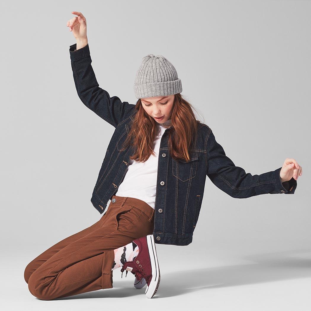 Girl wearing converse sneakers