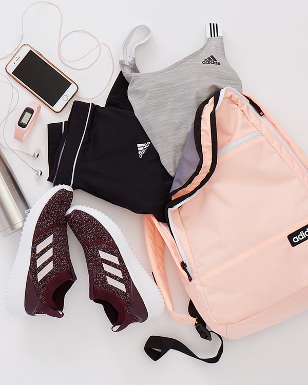 adidas workout clothes, sneakers, and backpack