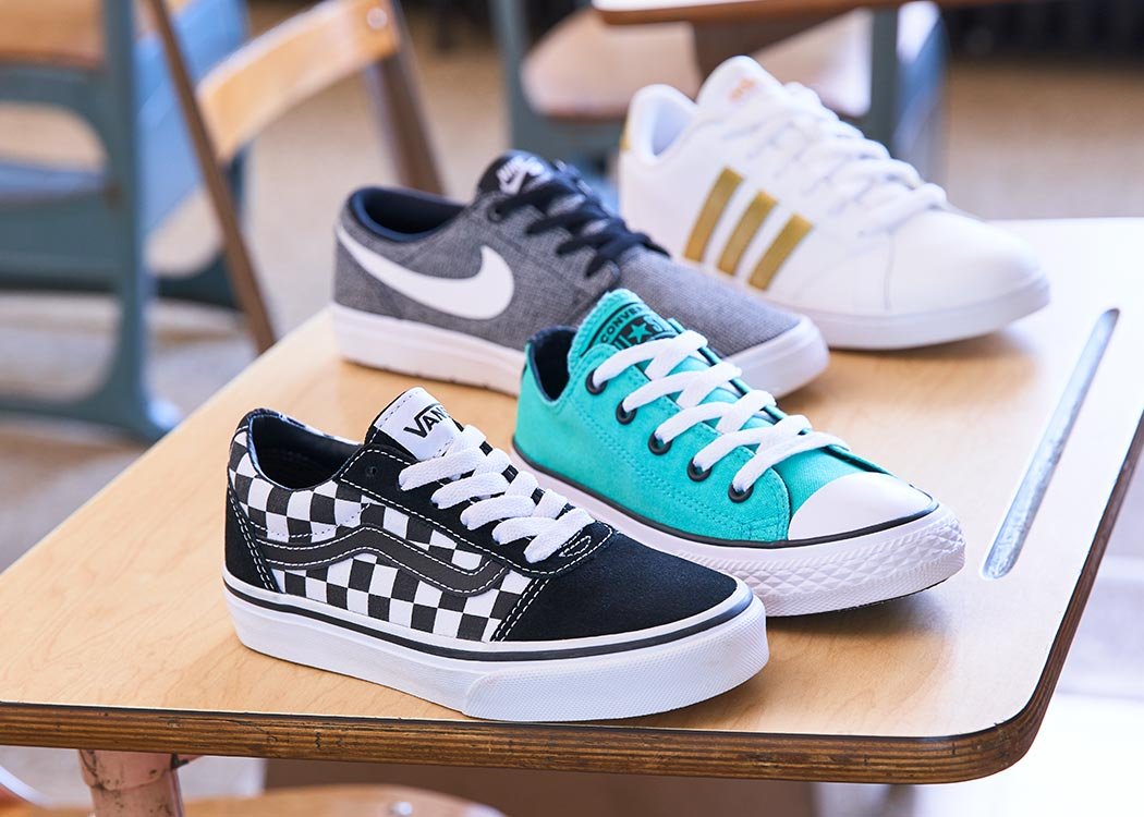 sneaker assortment with vans, converse, nike and adidas