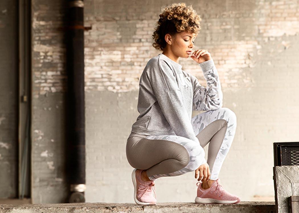 athletic woman wearing pink puma sneakers