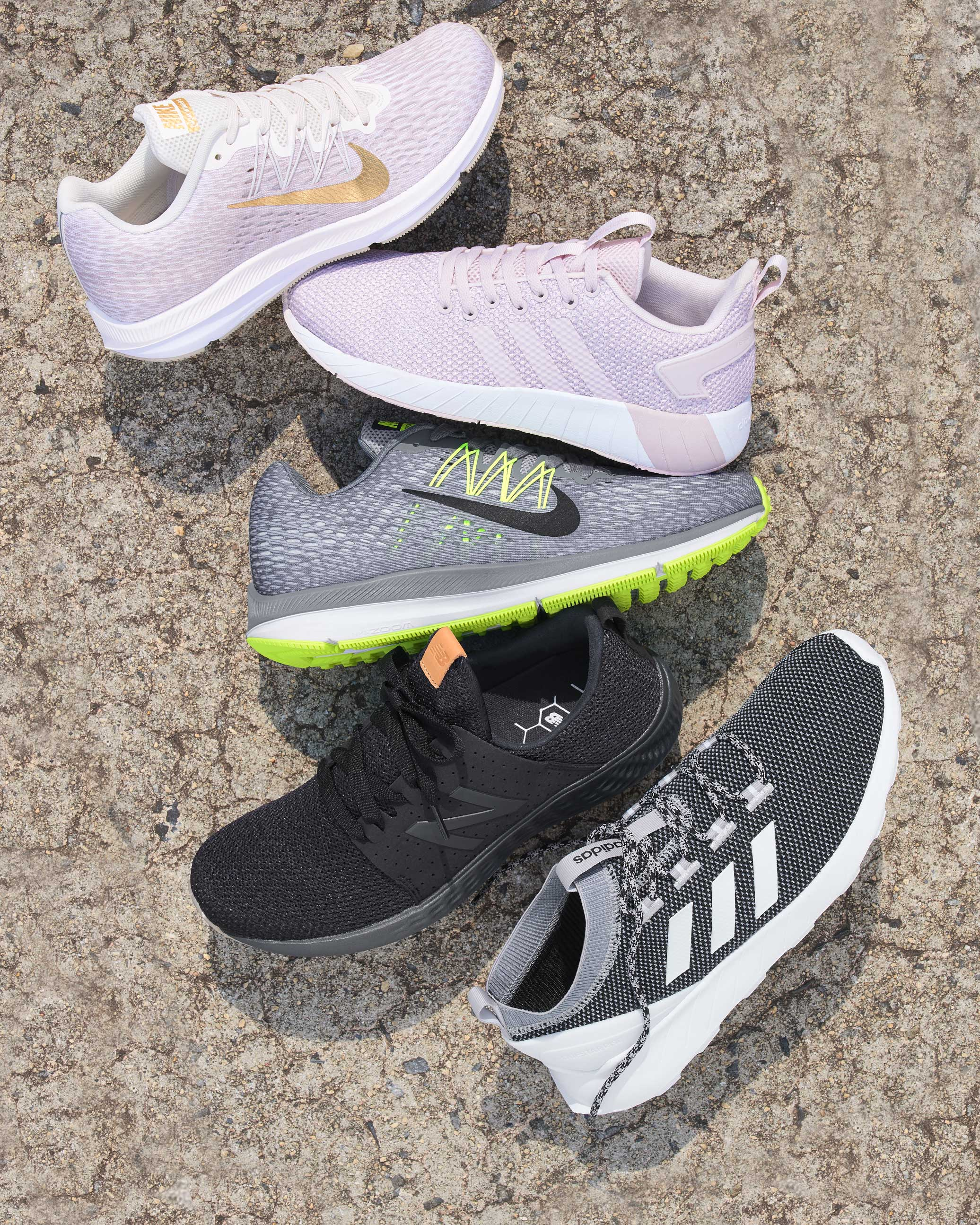 Assorted Nike, adidas, and New Balance athletic shoes
