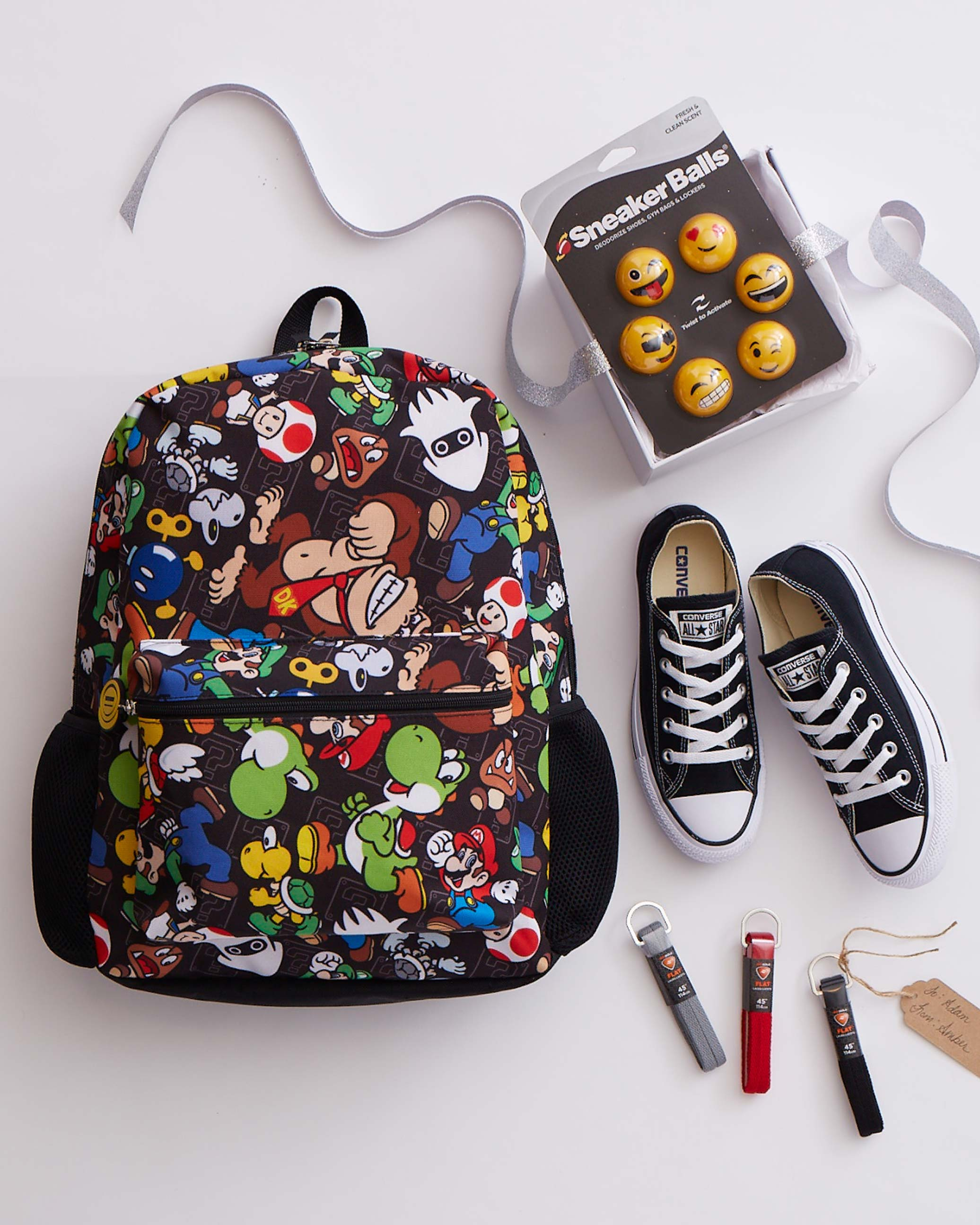 assorted gifts for Christmas, including a backpack and converse seakers