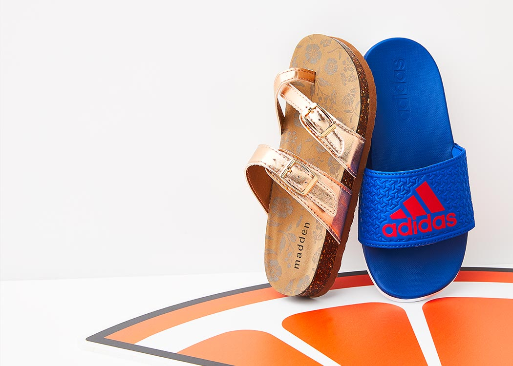 A gold Madden Girl footbed sandal and a blue adidas sport slide.