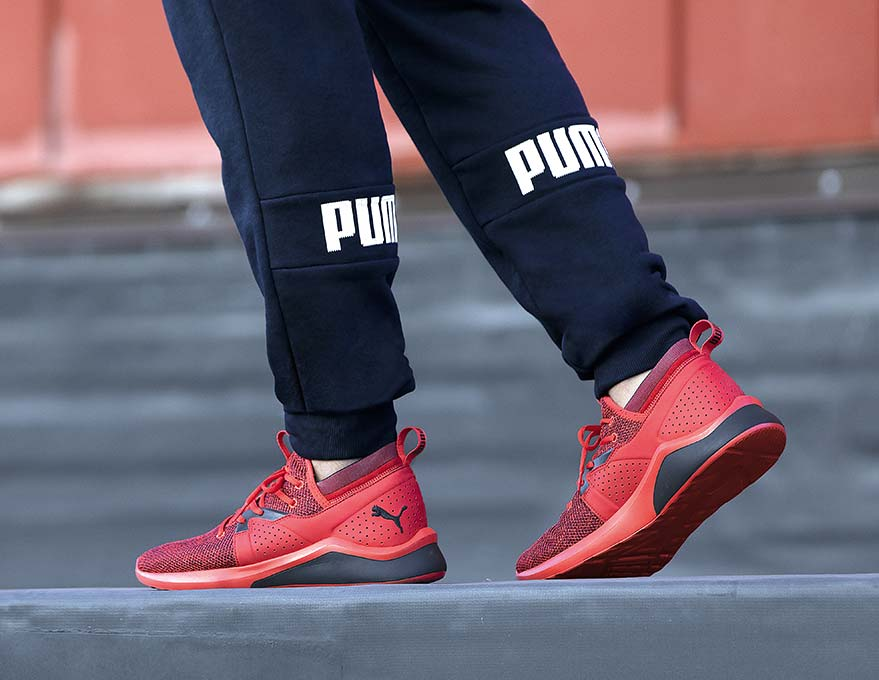 man wearing puma athletic shoes