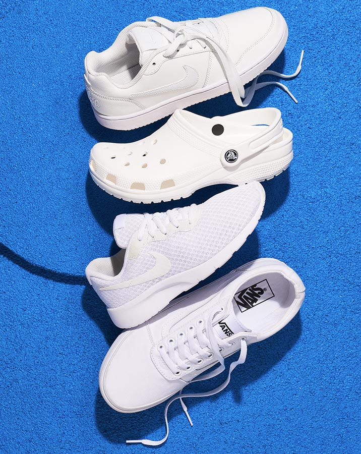 all white nike and vans sneakers with a crocs clog