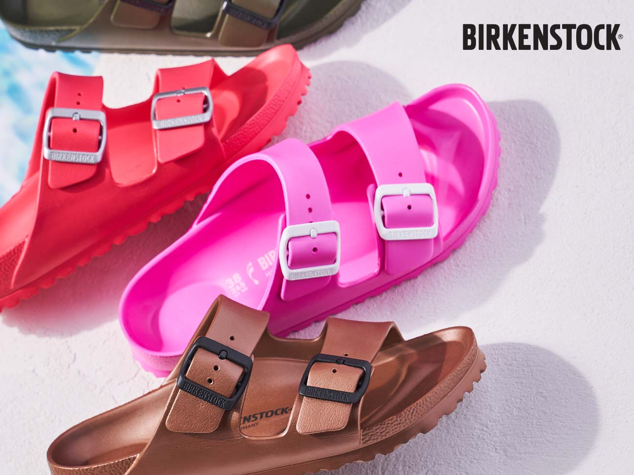 a group of birkenstock footbed sandals