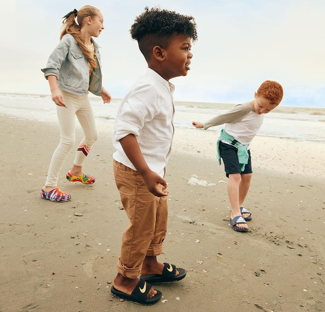 Reese, Micah and Tate wearing crocs, nike slides and adidas slides