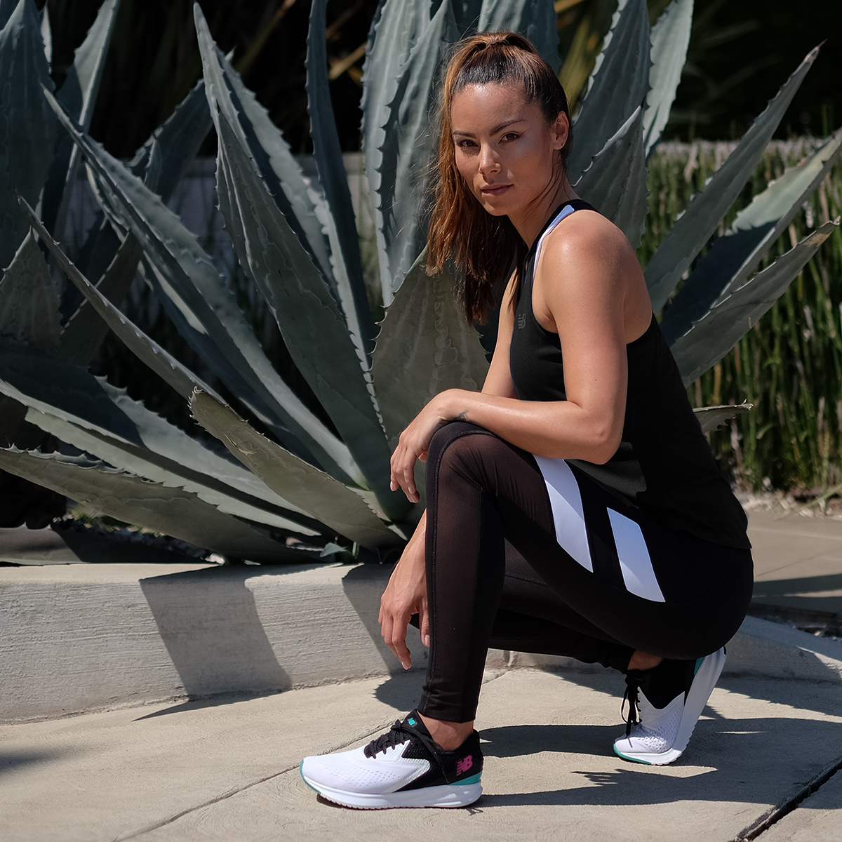 athletic woman wearing new balance sneakers