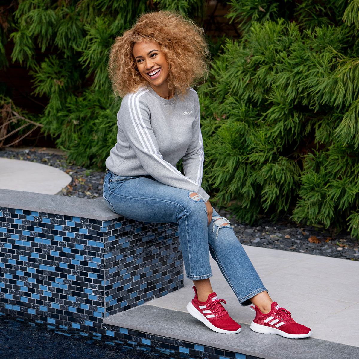 beautiful woman wearing red adidas sneakers