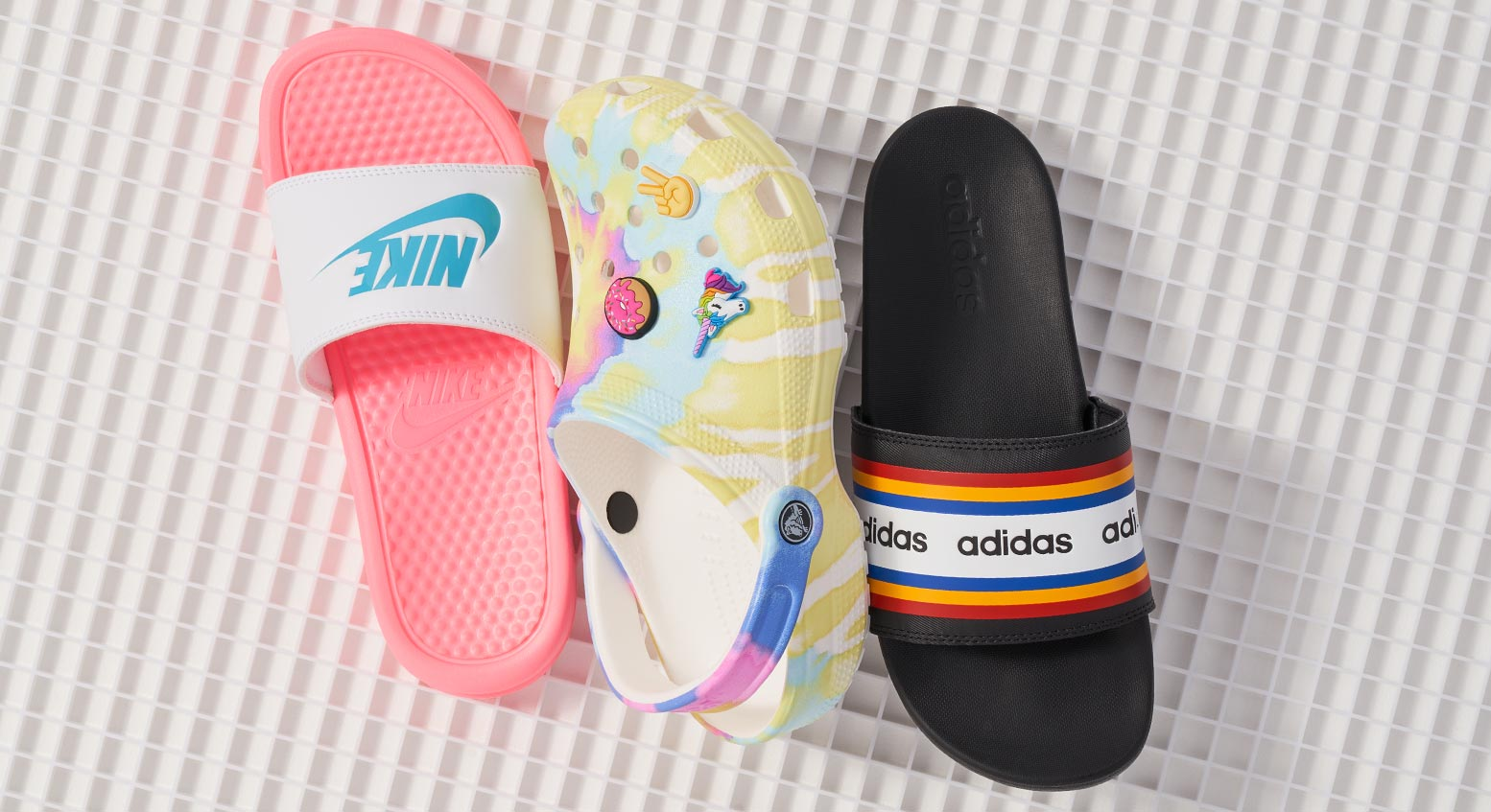 nike and adidas slides, with colorful crocs