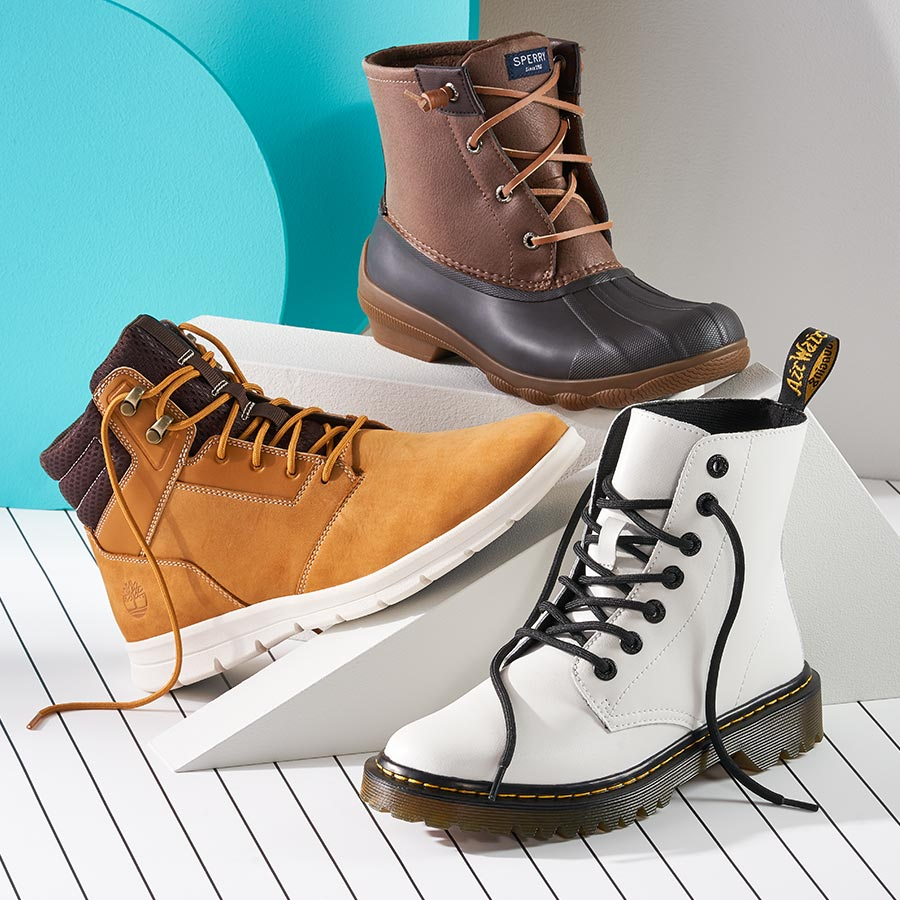 assorted timberland, dr martins, and sperry boots