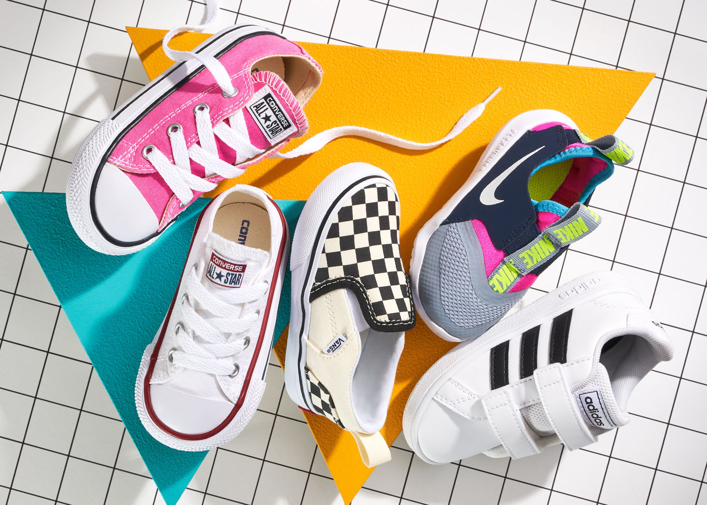 assorted small converse, vans, nike, and adidas sneakers