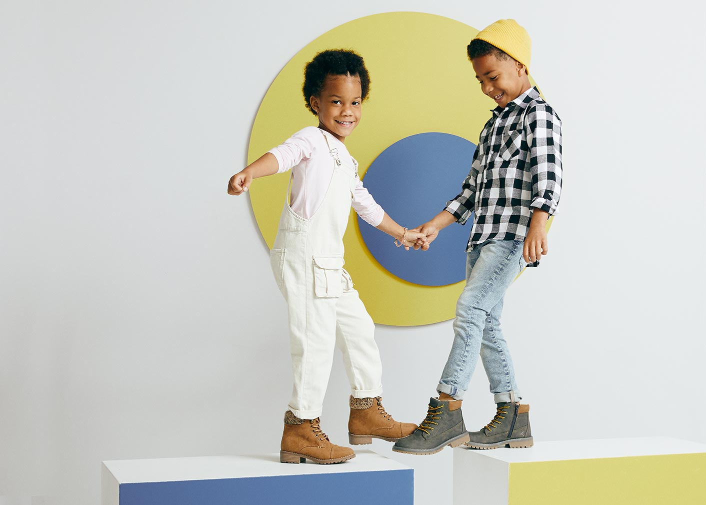 two cute boys wearing timberland and dr marten boots