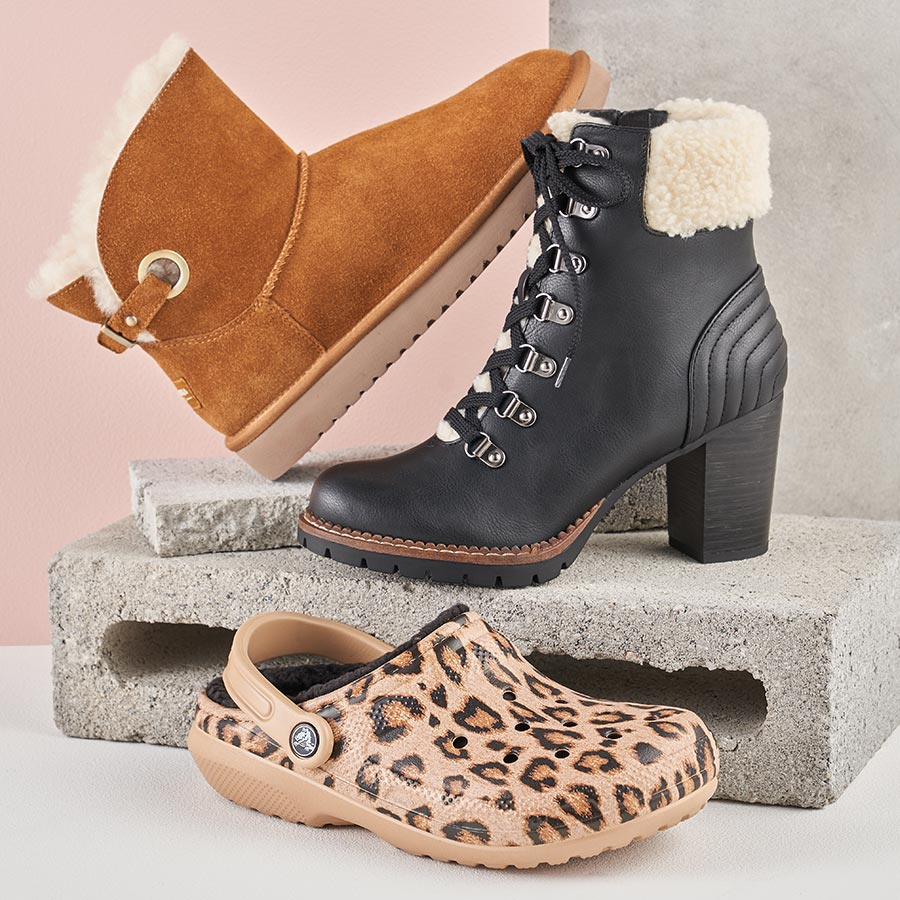 assorted fur lined boots and croc