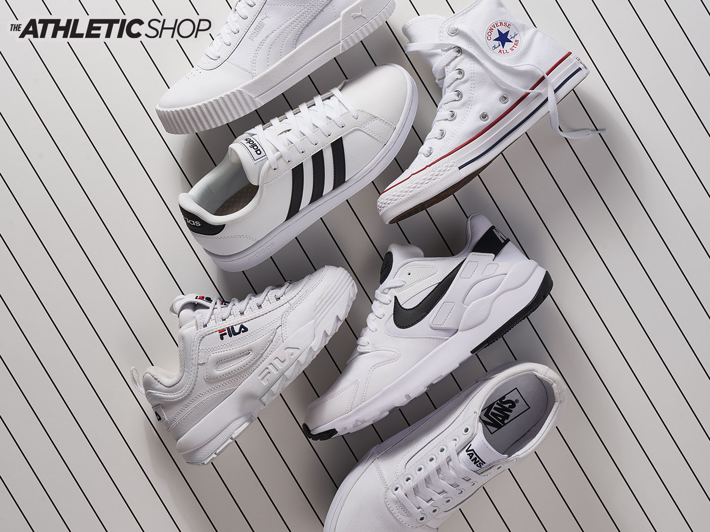 assorted white vans, fila, converse, adidas, and nike athletic sneakers