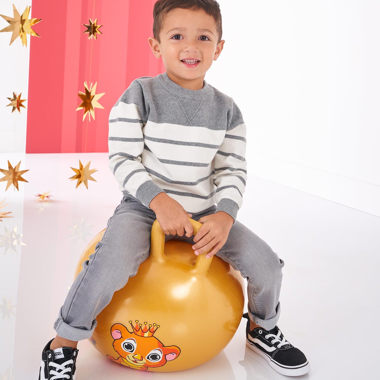 handsome real kid wearing hip black vans sneakers