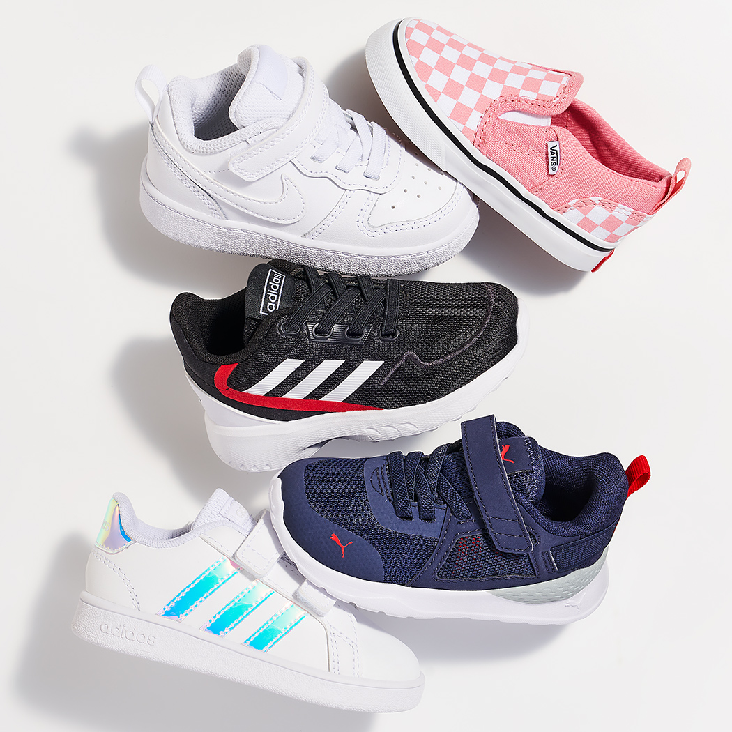 assorted tiny vans, nike, adidas, and puma sneakers