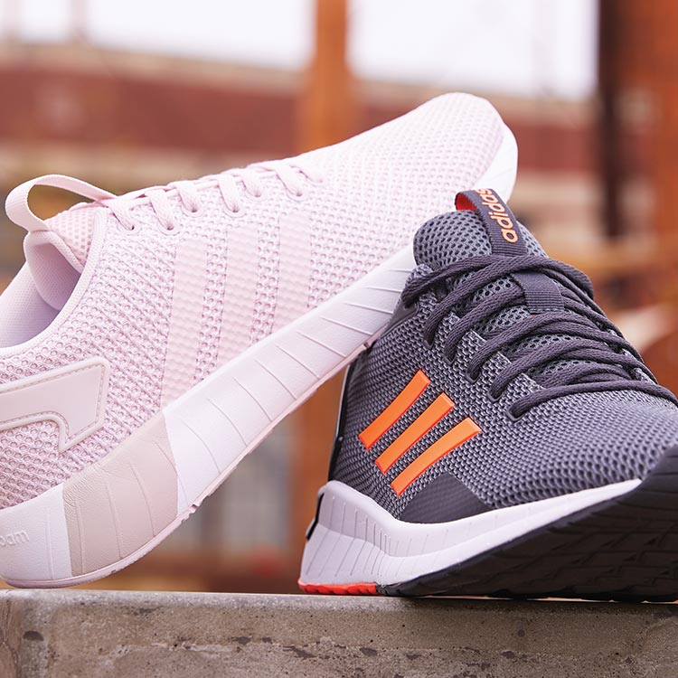 adidas running shoes, one pink and one grey