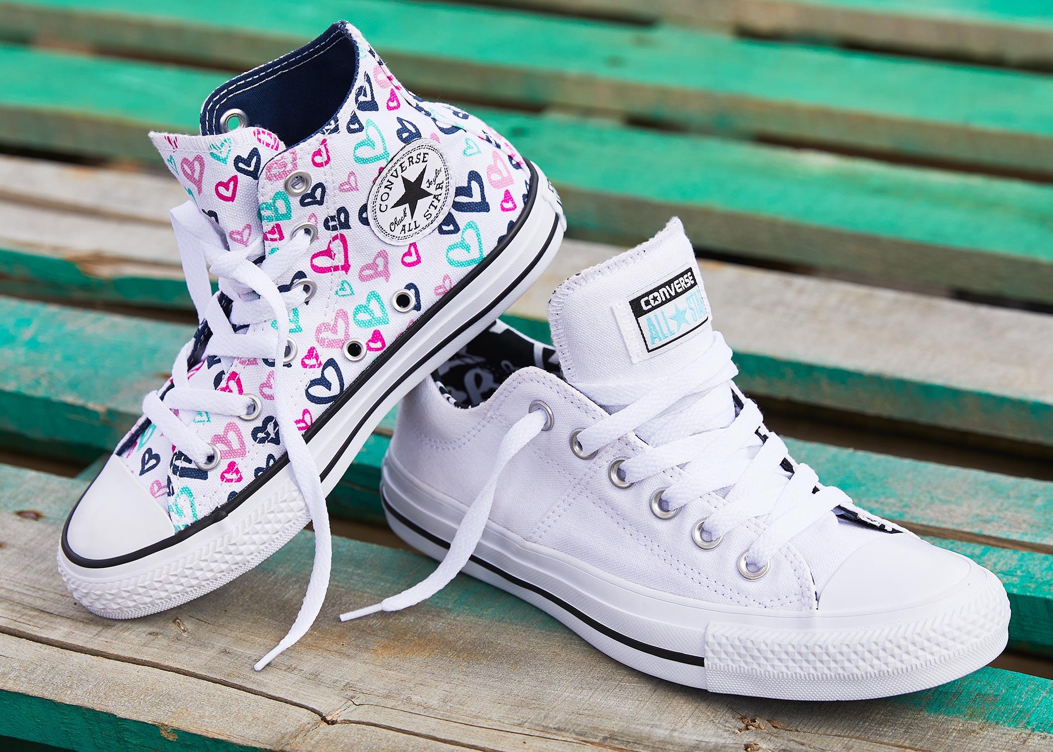 cute girls converse high top and a womens all star sneaker