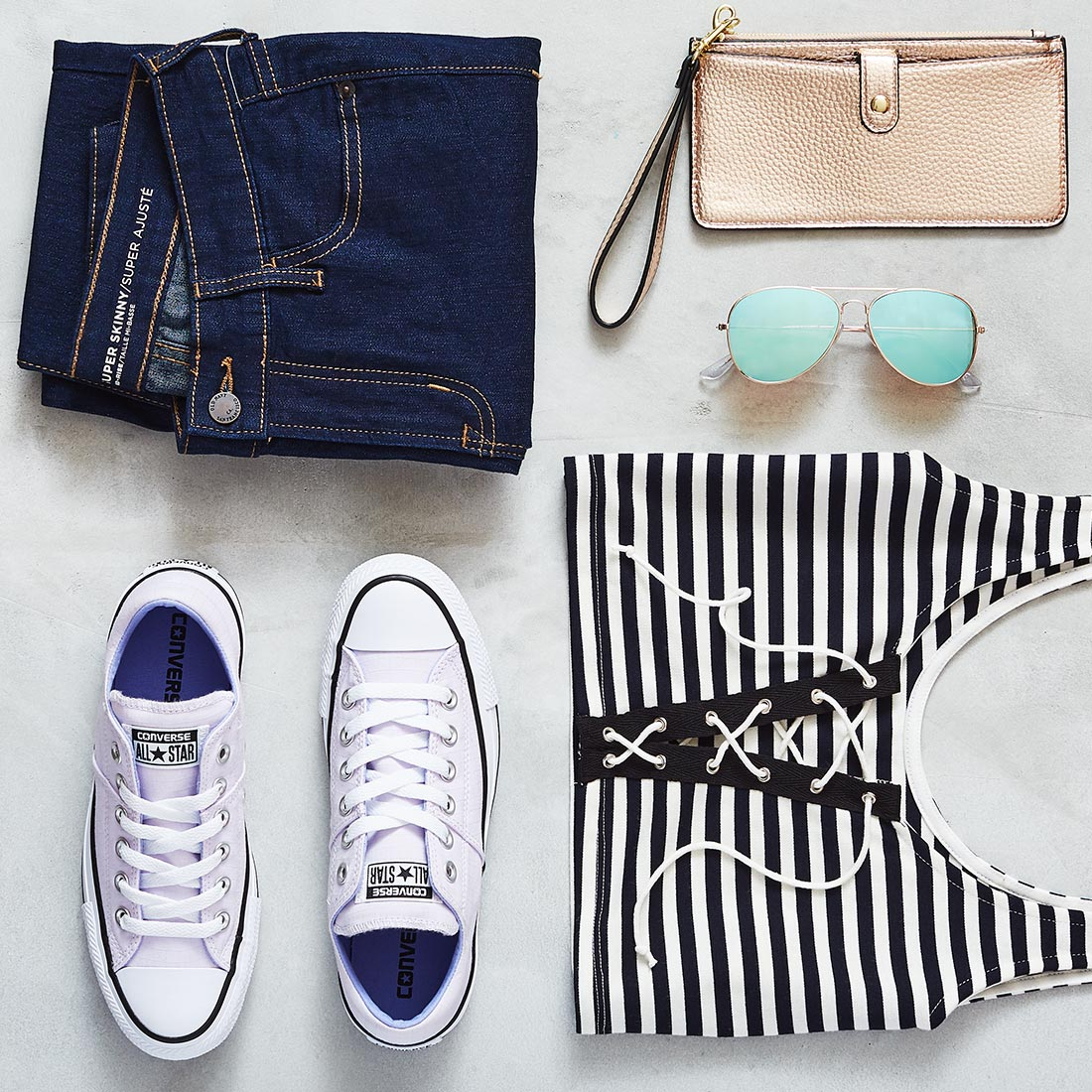 style shot of cute casual outfit with lavender converse sneakers
