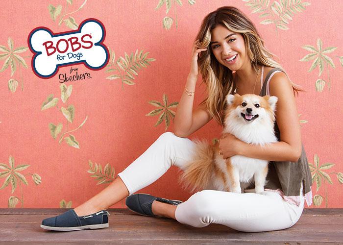 women wearing skecher bobs holding a cute fluffy dog